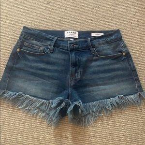 Fringe denim cutoff shorts